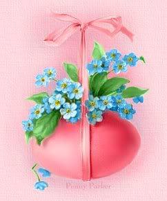 Rosa Osterei verziert mit hellblauen...