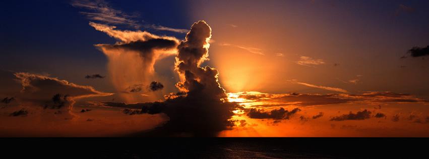 Wolkenmassiv schiebt sich vor tiefstehende Sonne