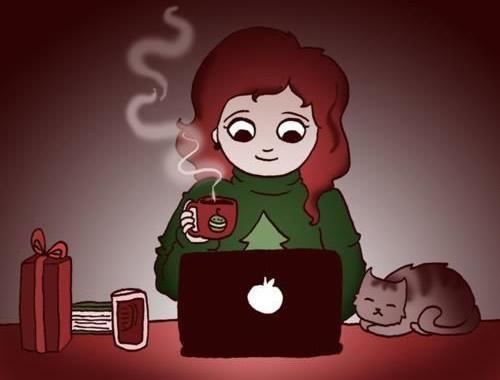 Mit einer heißen Schokolade vor dem Laptop