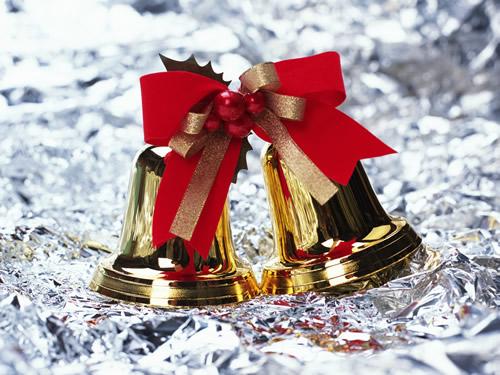 Zwei goldene Glocken auf Silberpapier